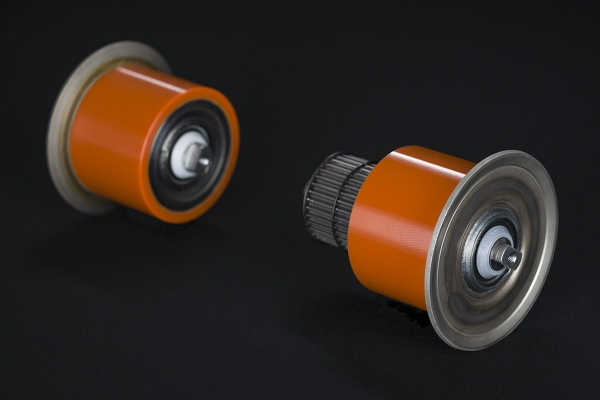 Coated rollers for skid conveyors